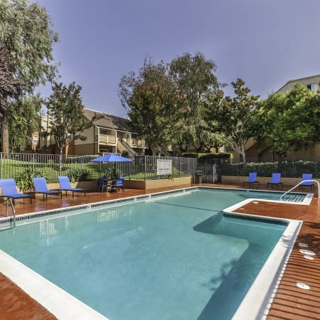Refreshing swimming pool at The Timbers Apartments in Hayward