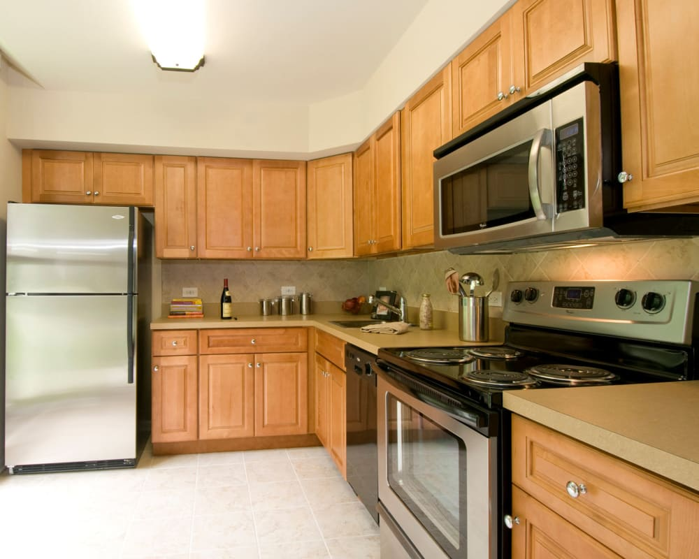Kitchen with stainless steel appliances at Park Lane at Sea View in Staten Island, New York