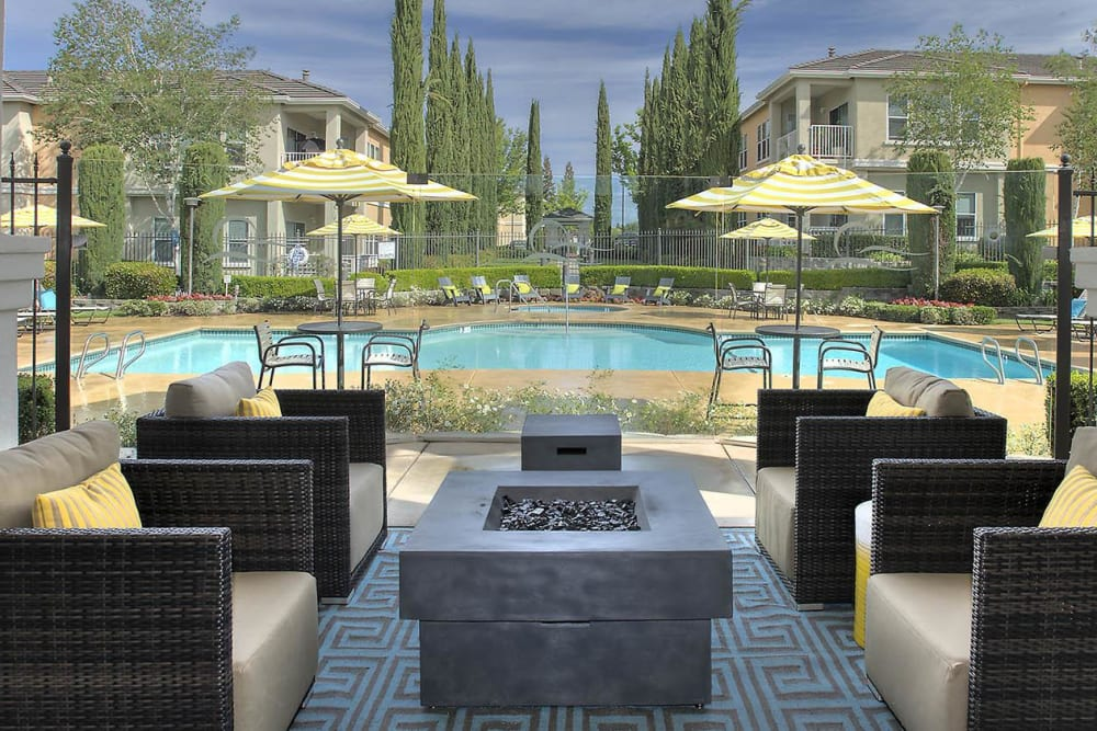 Cabana with comfortable seating around a propane fireplace at Iron Point at Prairie Oaks in Folsom, California