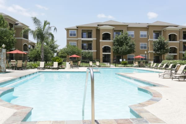 Pool area at The Villas at River Park West in Richmond, TX