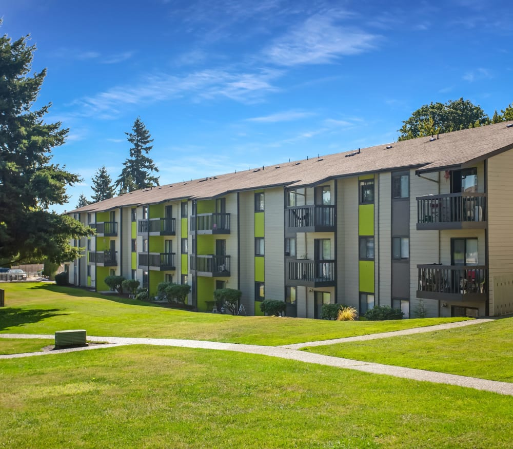 Beautiful landscape along walkways at Terra Apartment Homes in Federal Way, Washington