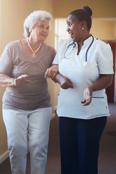 A resident walking with their nurse at Brightwater Senior Living of Capital Crossing in Regina, SK