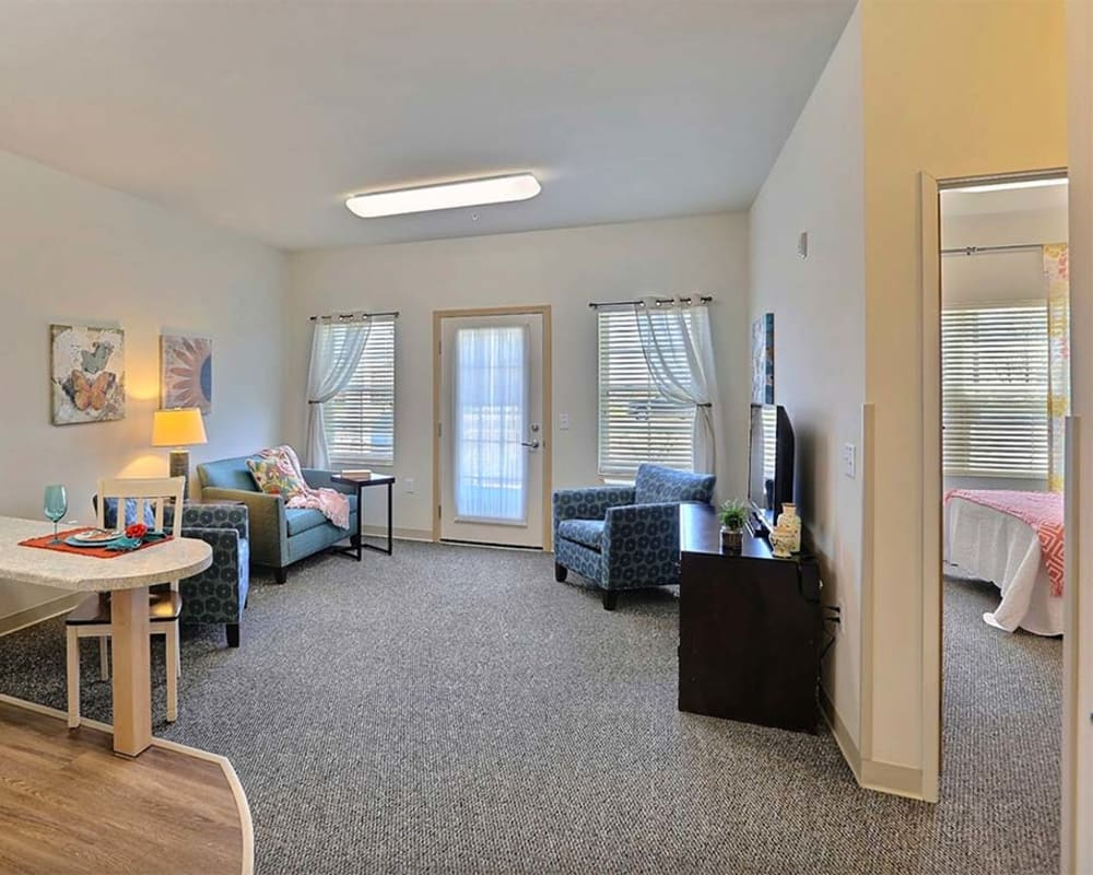 Living room and private bedroom in apartments at Milestone Senior Living in Stoughton, Wisconsin.