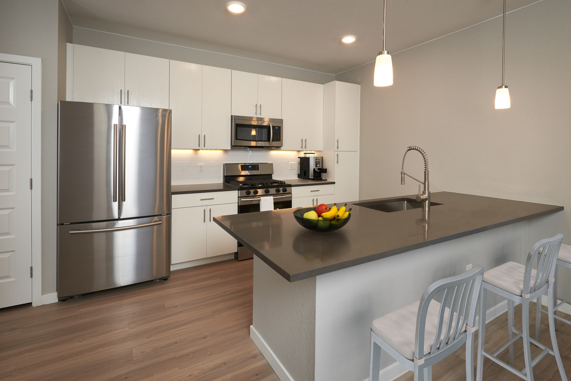An open kitchen with expansive counter space at Hawthorne Hill Apartments in Thornton, Colorado