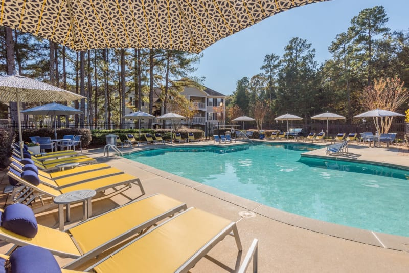 Lounge chairs poolside at The Oxford in Conyers, Georgia