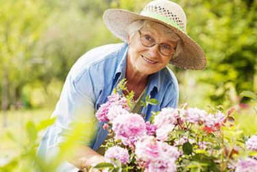 Resident gardening at Grand Villa of New Port Richey in New Port Richey, FL