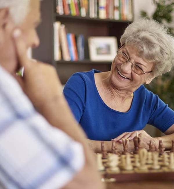 Couple playing chess at Brightwater Senior Living of Highland