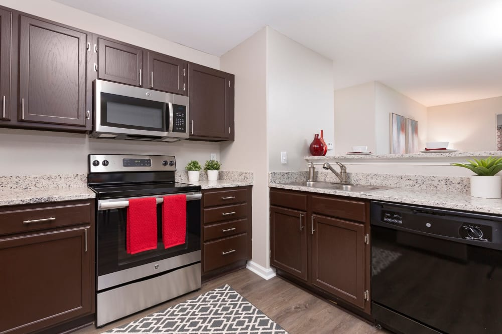 Beautiful kitchen with dark wood cabinets and very spacious at Ascend @ 1801 In Charlotte NC