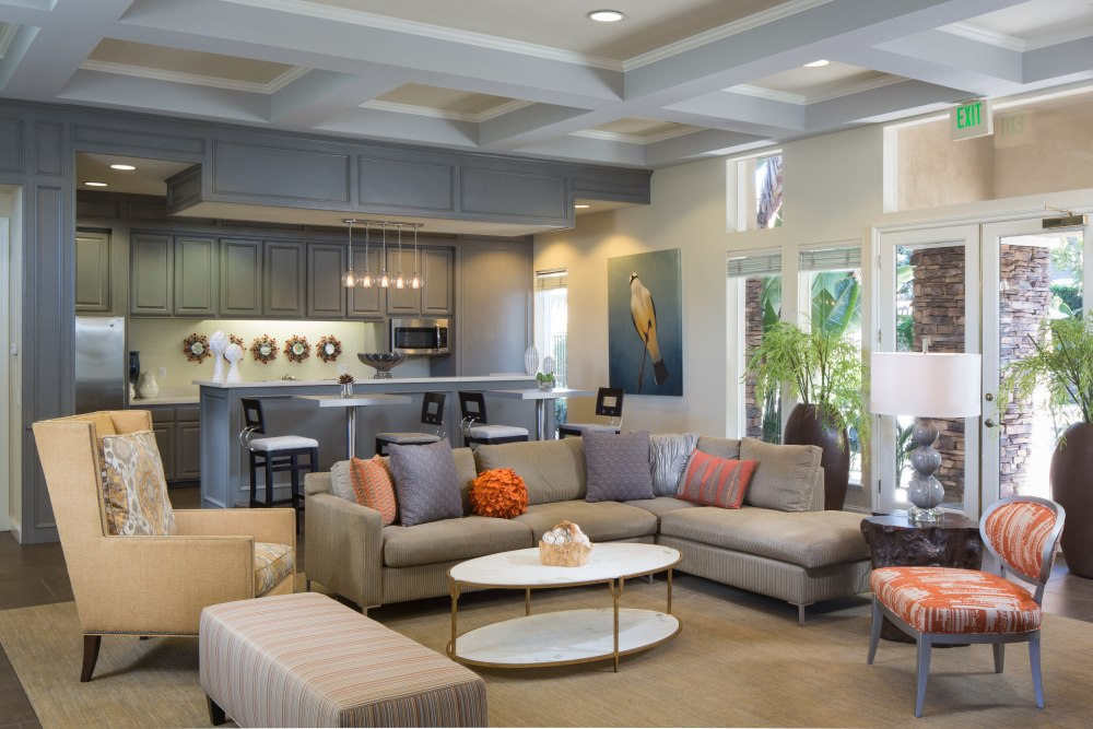 Clubhouse lounge with a community kitchen at Alicante Apartment Homes in Aliso Viejo, California