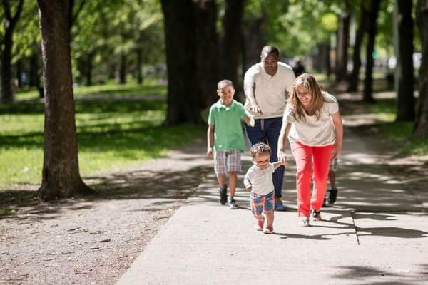 Family going on a walk together near The Lakes at 8201 in Merrillville, Indiana