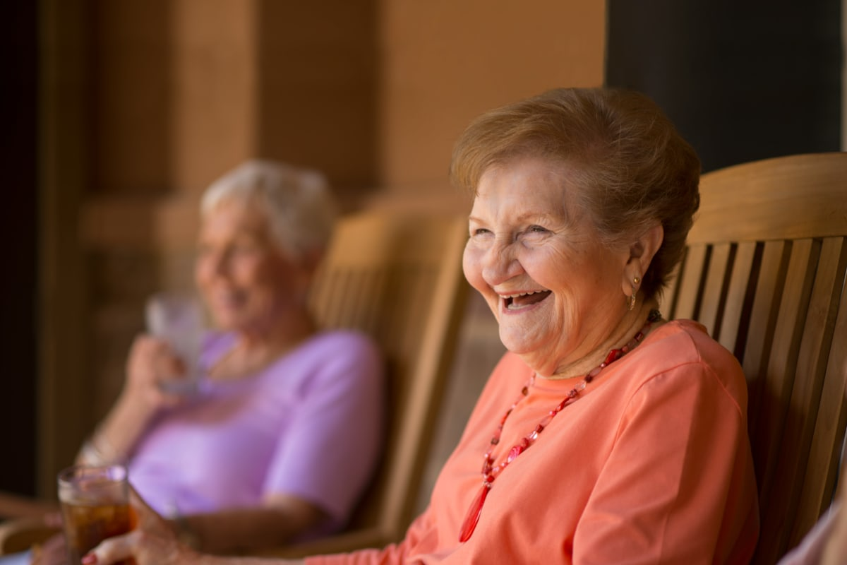 A smiling resident at Isle at Watercrest Mansfield in Mansfield, Texas