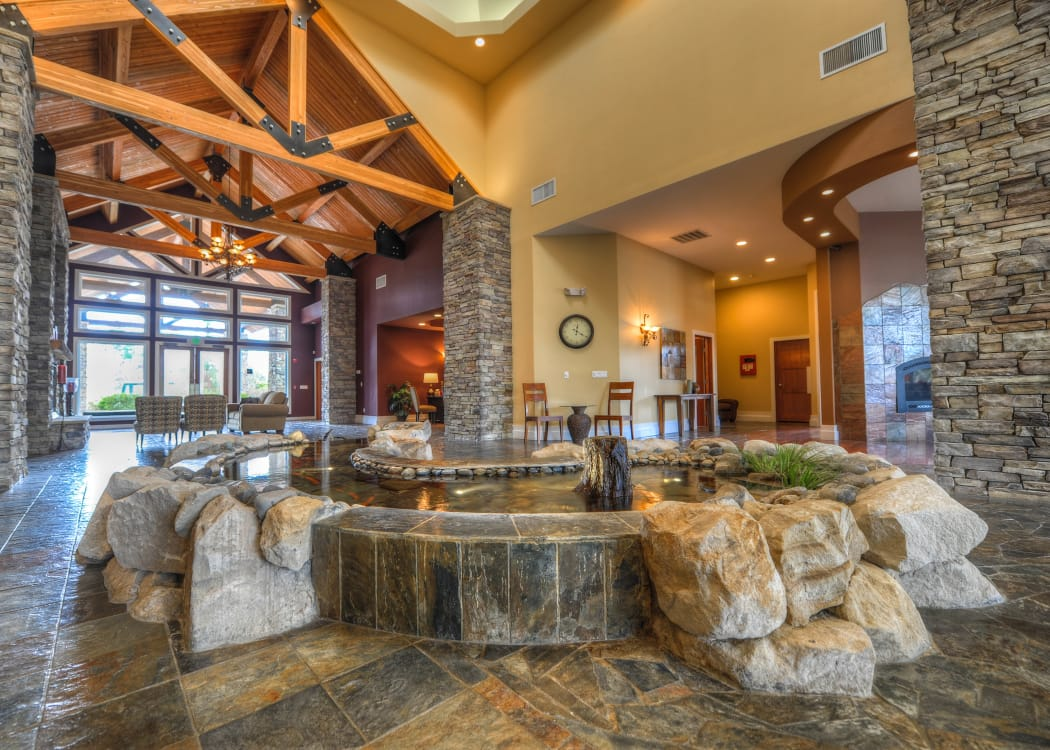Lobby area with an indoor pond at Sierra Sun in Puyallup