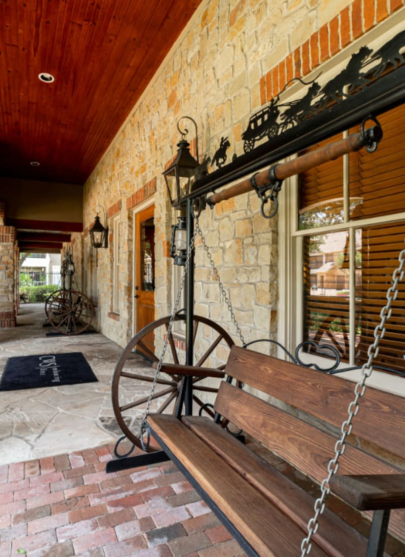 Antique swing bench outside main entrance to Marquis at Bellaire Ranch in Fort Worth, Texas