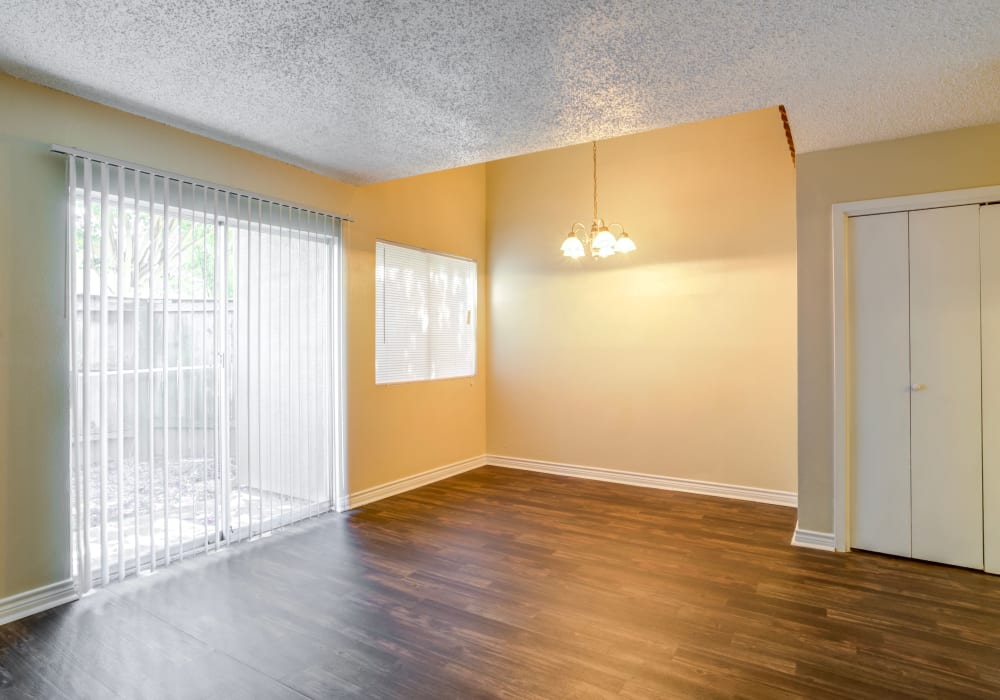 Spacious living room with natural light at Riverstone Apartments, TX