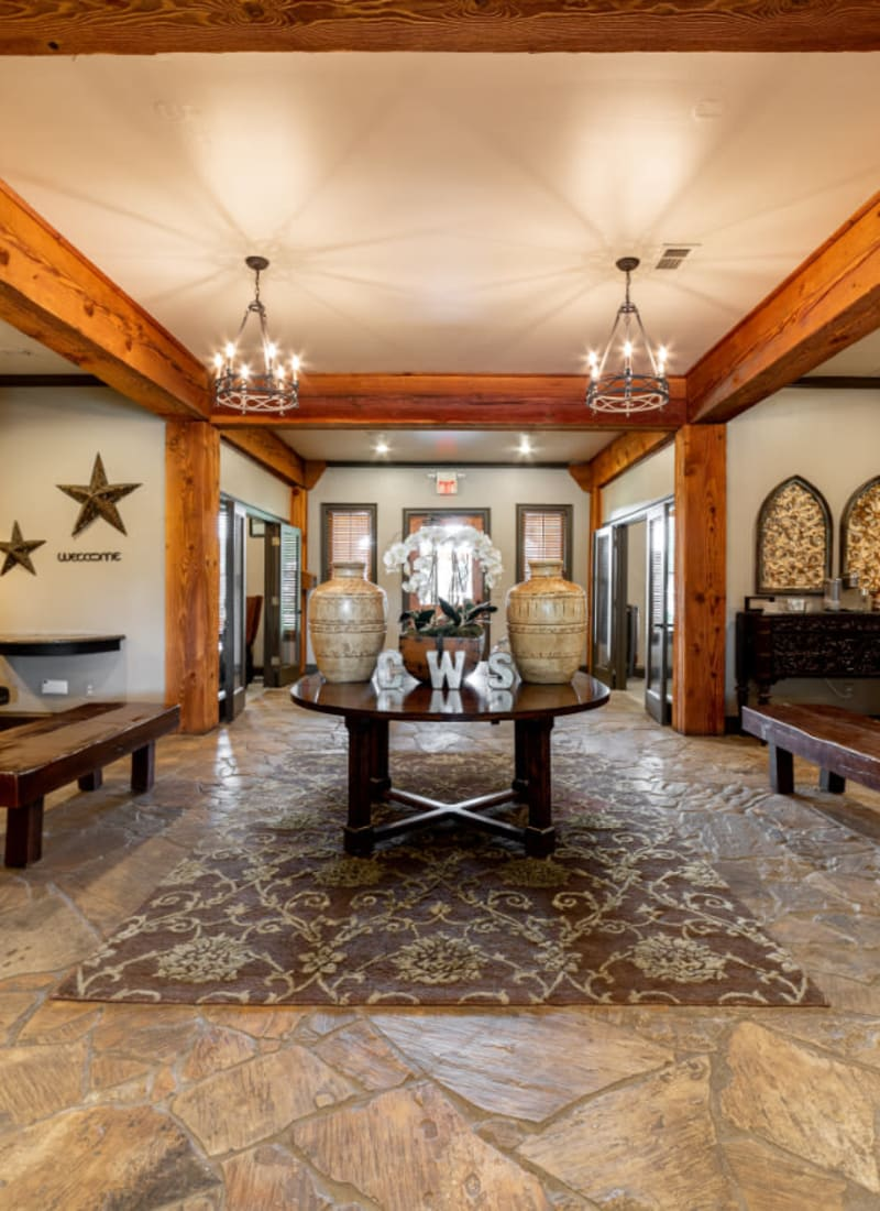 Rustic lobby entrance with benches at Marquis at Bellaire Ranch in Fort Worth, Texas