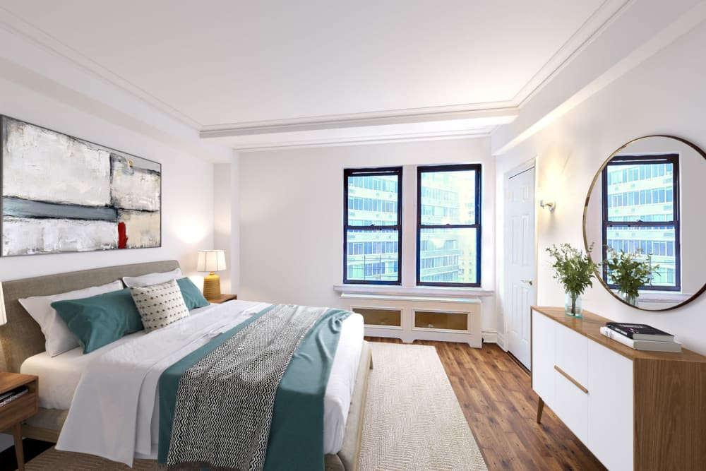 Large bedroom with wood-style flooring and a double window with a view at The Sutton Collection in New York, New York