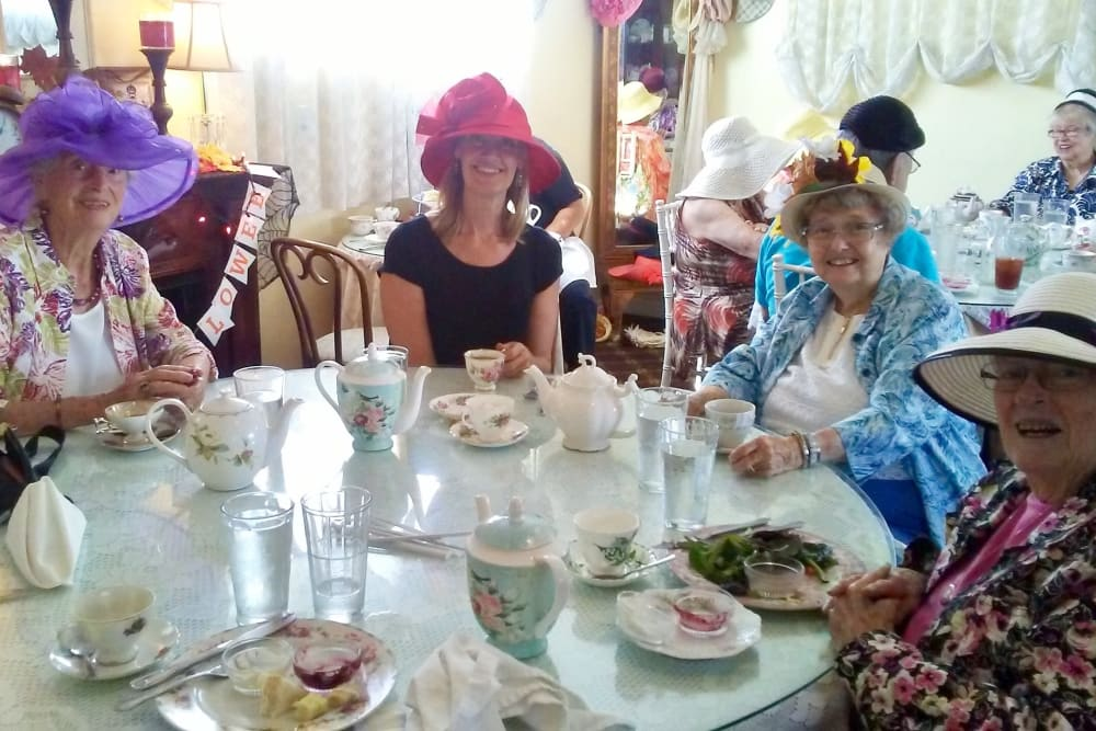 Residents and friends at a tea party at Merrill Gardens at Huntington Beach in Huntington Beach, California.