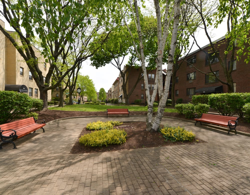 Beautifully landscaped courtyard with benches and pathways at Clemens Place in Hartford, Connecticut