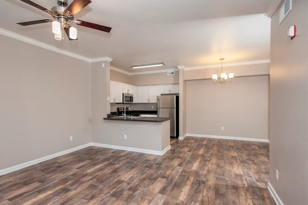 Spacious room with hardwood floors and beautiful light fixture at The Vintage at South Meadows Condominium Rentals in Reno, Nevada