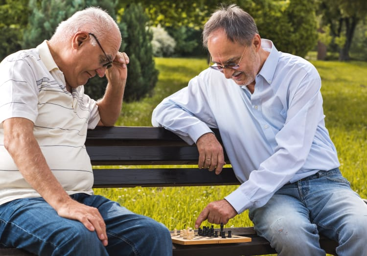 Residents of The Wellington play a game of chess together.