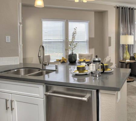 Kitchen with a stainless-steel sink at Iron Point at Prairie Oaks in Folsom, California