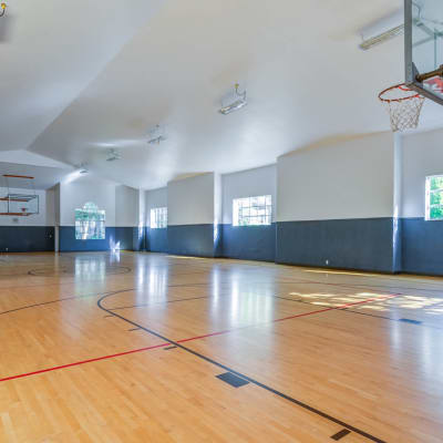 Full-size indoor basketball court at Walden Pond Apartments in Everett, WA