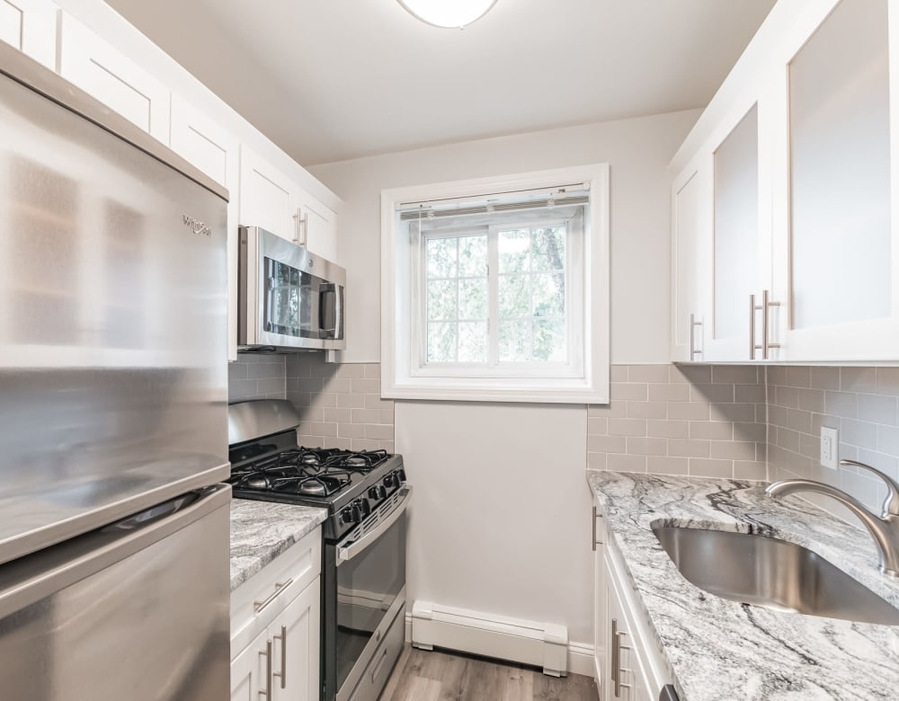 Bright kitchen with stainless appliances at Eagle Rock Apartments at Carle Place in Carle Place, New York