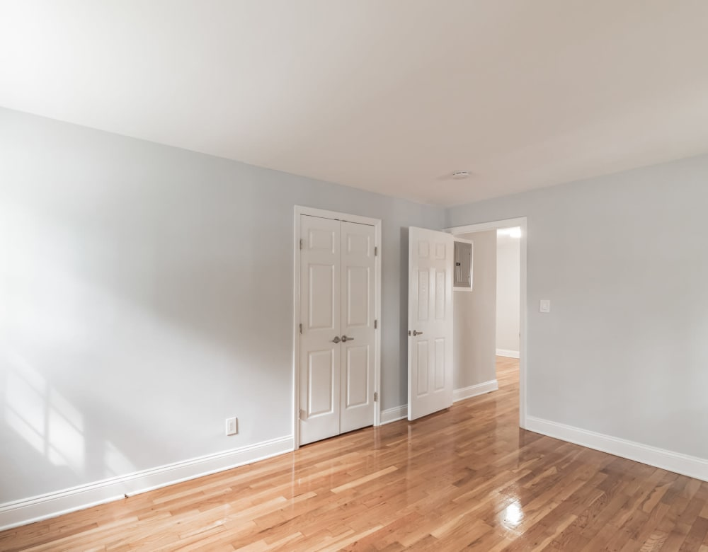 Hardwood flooring in bedroom at Eagle Rock Apartments at Carle Place in Carle Place, New York
