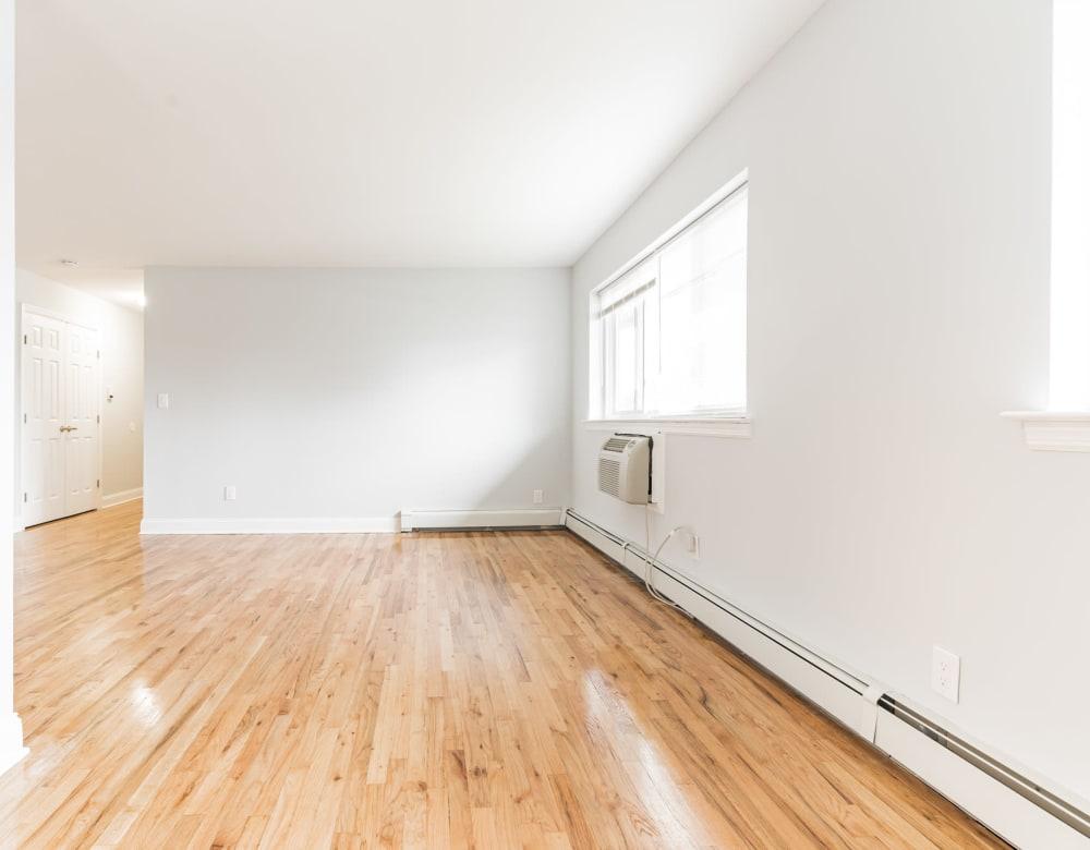 Hardwood floored living room at Brixton Lane in Levittown, New York