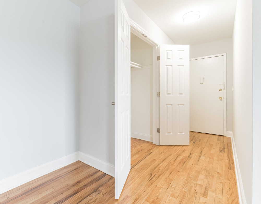 Entry with large double doored closet at Brixton Lane in Levittown, New York