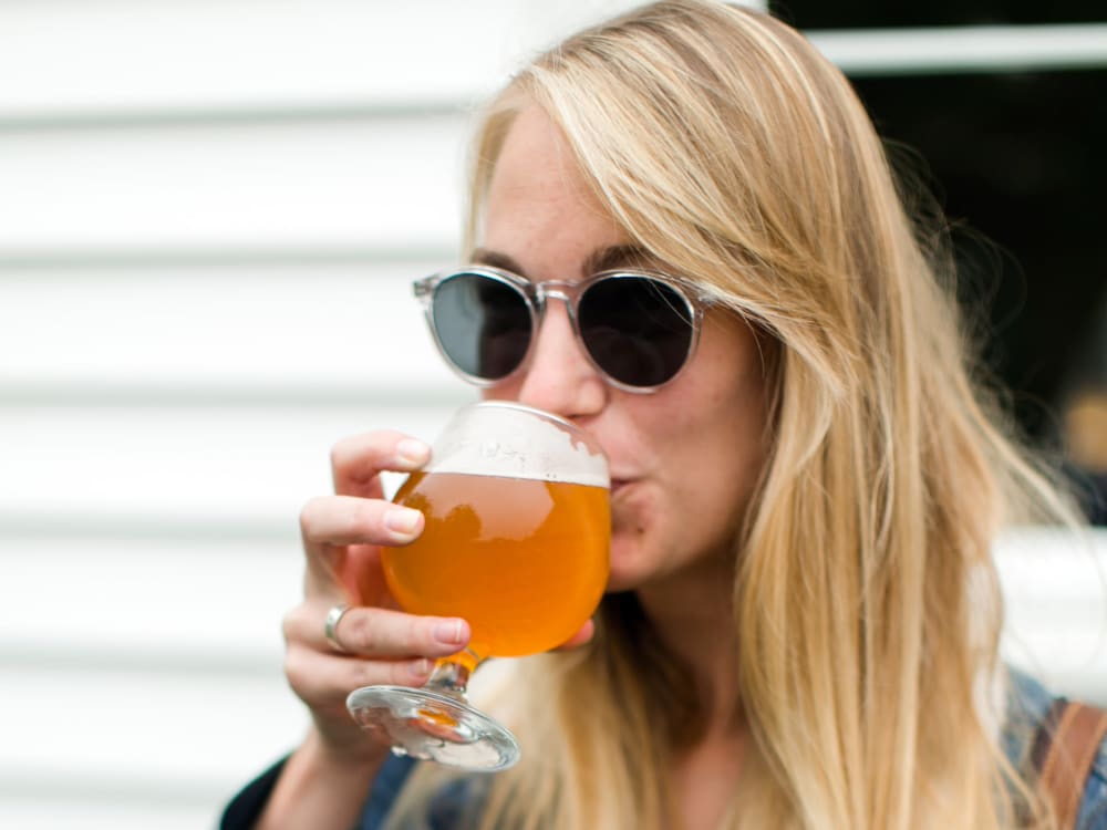 Resident sampling a craft brew at Sofi Lake Oswego in Lake Oswego, Oregon