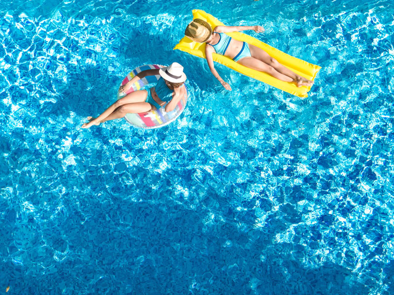 Two residents in the pool at Gramercy Scottsdale in Scottsdale, Arizona