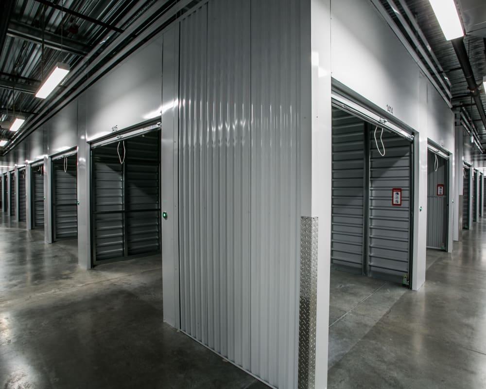 Indoor storage units with open doors at Golden State Storage - Blue Diamond in Las Vegas, Nevada