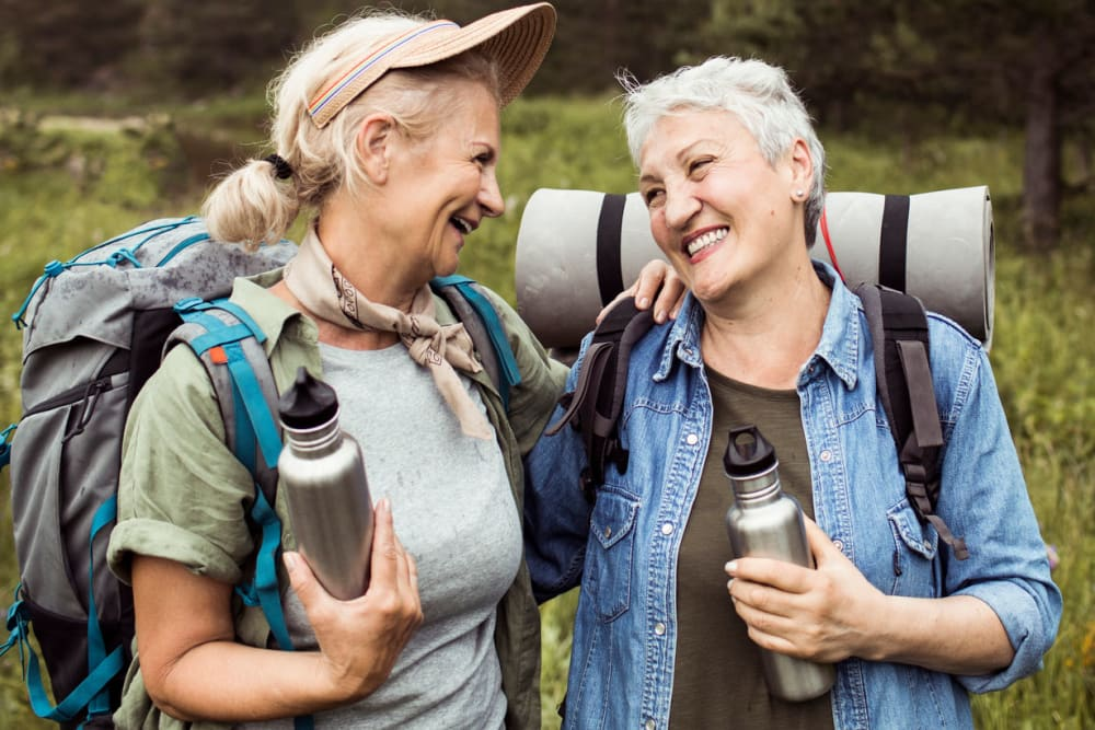 Two women backpacking near Applewood Pointe of Westminster in Westminster, Colorado