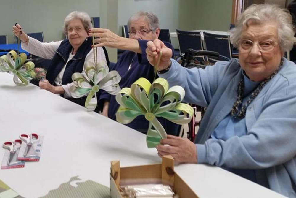 Residents displaying their craft projects at Prairie Meadows Senior Living in Kasson, Minnesota.