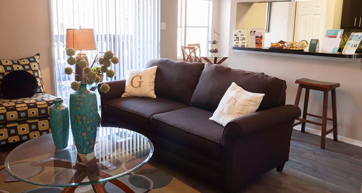 Living room with breakfast bar at apartments in Carrollton, Texas