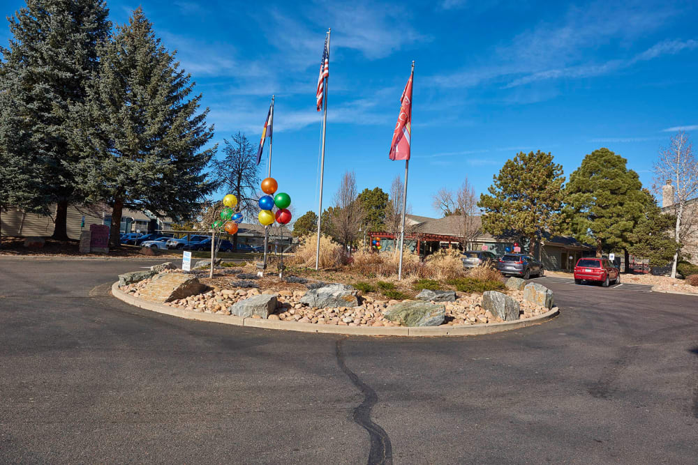 Rotary with flags at entrance to Hampden Heights Apartments in Denver, Colorado