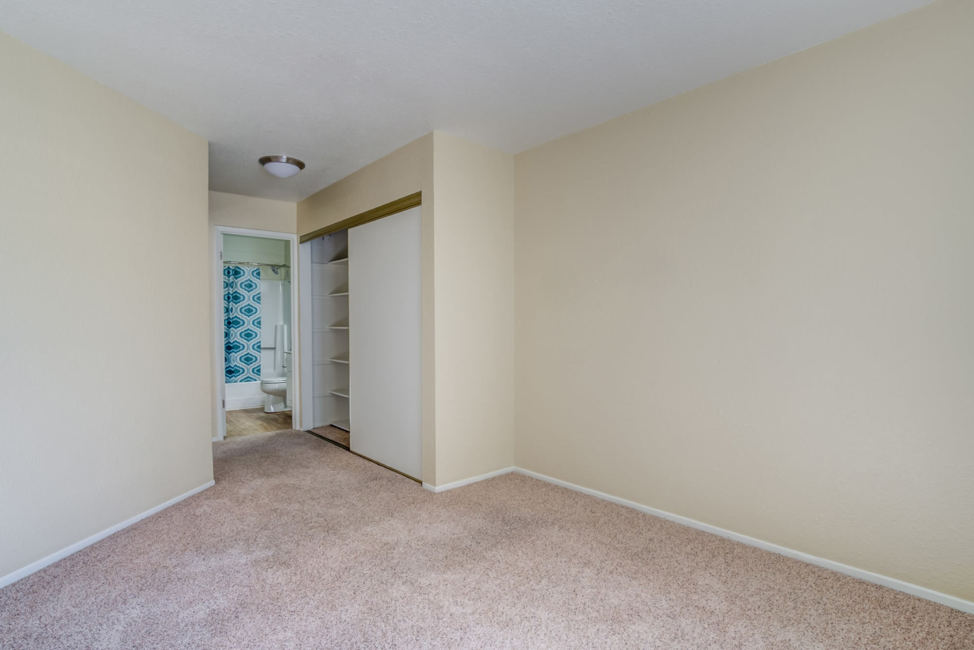 Spacious Empty Bedroom at Sommerset Apartments in Vacaville, CA