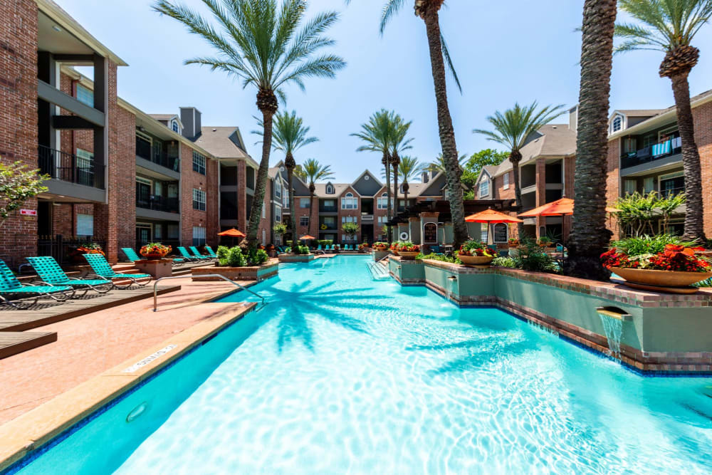 Sparkling pool nestled between units at Marquis on Pin Oak in Houston, Texas