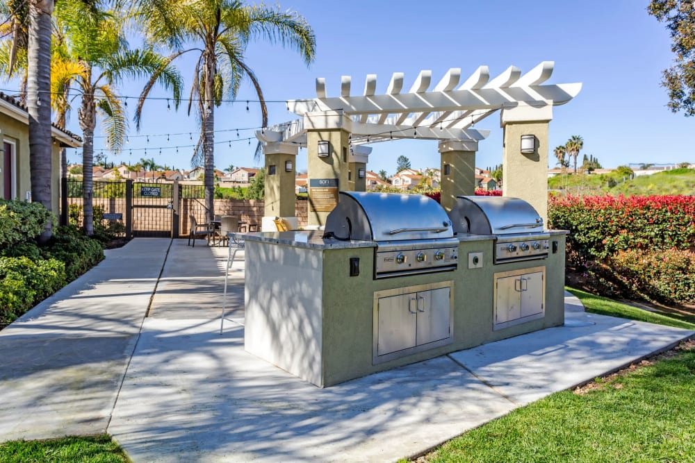Barbecue area with gas grills at Sofi Highlands in San Diego, California