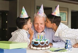 Senior resident celebrating his birthday with his family in Bonita Springs, Florida