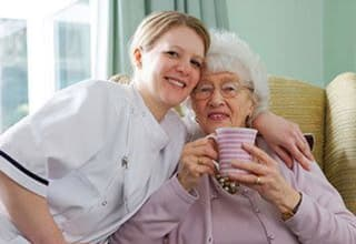 Senior living resident with nurse in Greer