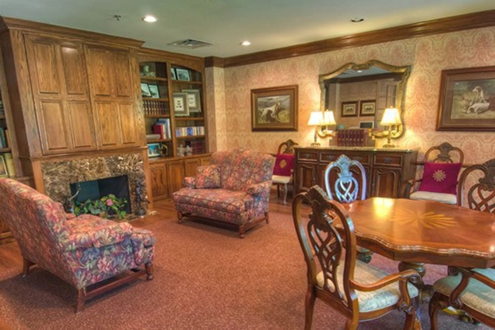 Comfortable fireside lounge area at Mansion at Waterford Assisted Living in Oklahoma City, Oklahoma
