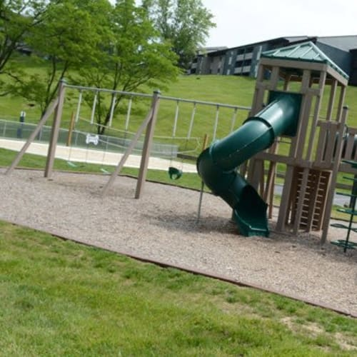 Playground and sand volleyball court at Lakeside Landing Apartments in Lakeside Park, Kentucky