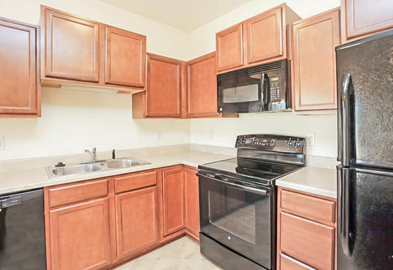 Kitchen with black appliances at Johnston Heights in Johnston, Iowa