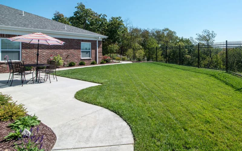 Outdoor courtyard with covered seating at Colony Pointe Senior Living in Columbia, Missouri