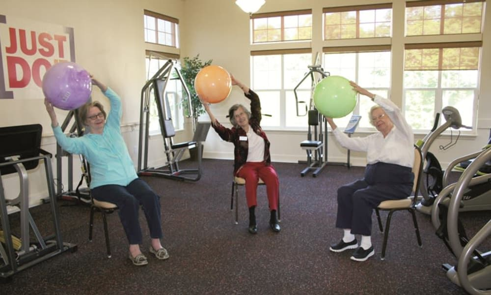 Residents exercising in the gym at Cedarview Gracious Retirement Living in Woodstock, Ontario