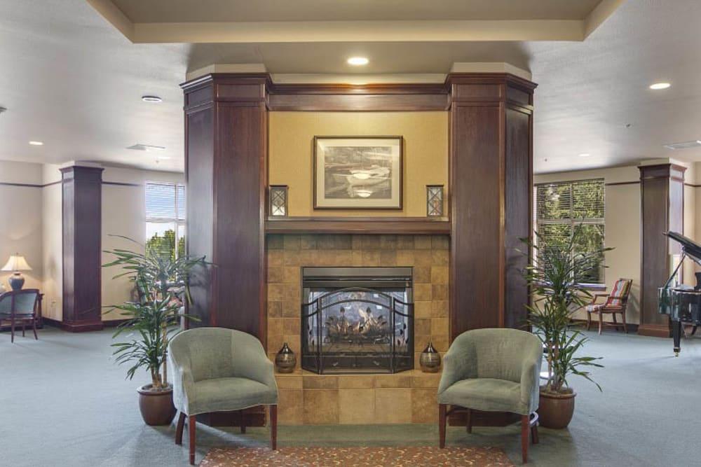 Lobby with fireplace at Merrill Gardens at Huntington Beach in Huntington Beach, California.