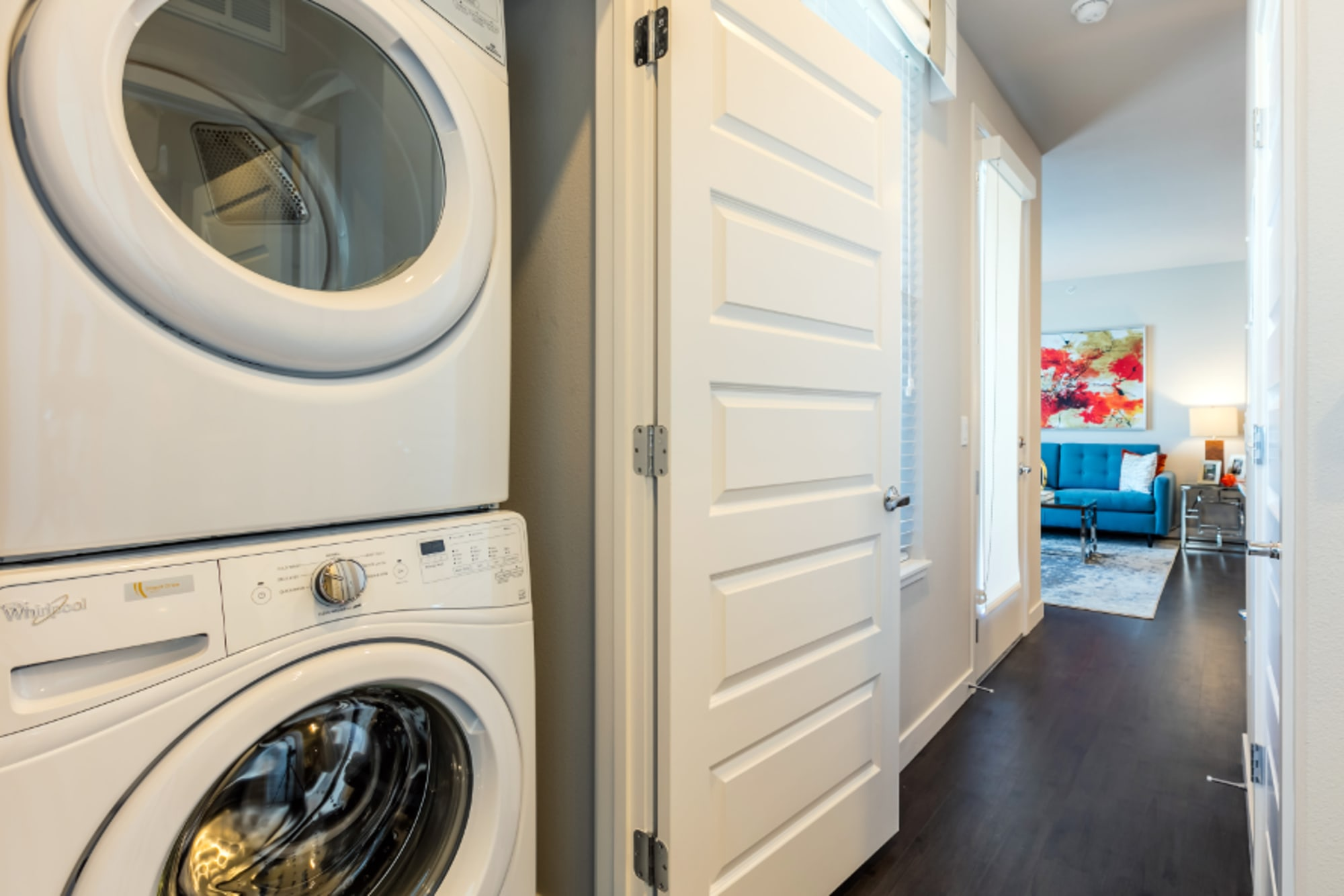 A stacked washer and dryer at Strata Apartments in Denver, Colorado