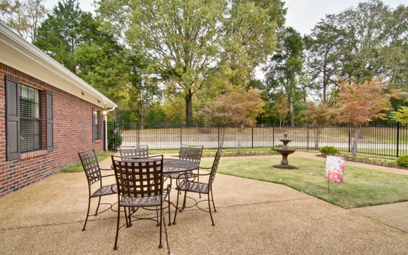 Outdoor patio with chairs at Olive Grove Terrace Senior Living in Olive Branch, Mississippi